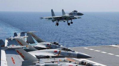 辽宁舰南海实战演练 歼-15战机变换多种阵型蔚为壮观
