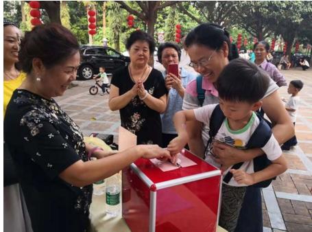 """各界合力为锦绣香江""""好保安""""李立光募捐,共建和谐社区"""
